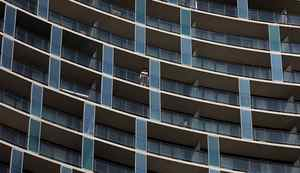 .A man looks out from his balcony of a condominium building in the Front Street area in Toronto on March 22, 2012.