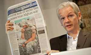 "Australian founder of whistleblowing website, 'WikiLeaks', Julian Assange, holds up a copy of today's Guardian newspaper during a press conference in London on July 26, 2010. The founder of a website which published tens of thousands of leaked military files about the war in Afghanistan said Monday they showed that the ""course of the war needs to change"". In all, some 92,000 documents dating back to 2004 were released by the whistleblowers' website Wikileaks to the New York Times, Britain's Guardian newspaper, and Germany's Der Spiegel news weekly. Assange also used a press conference in London to dismiss the White House's furious reaction to the disclosures."