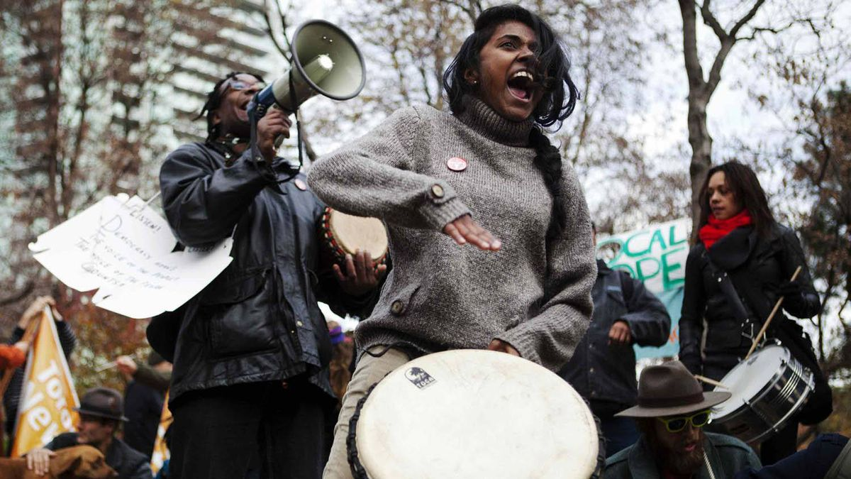 """People play music inside St. James park during the """"Occupy Toronto"""" movement in Toronto, Nov. 19, 2011."""