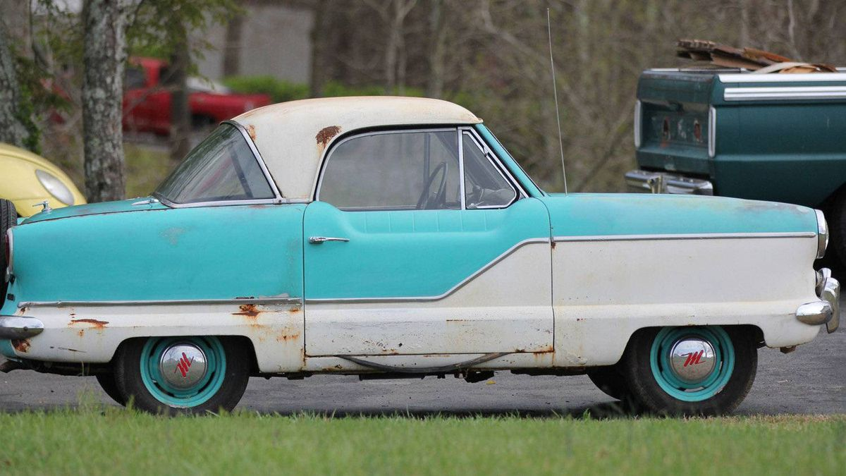 "Nash Metropolitan. Built between 1953 and 1961, the Metropolitan was advertised as ""Milady's perfect companion for shopping trips."" The manufacturer claimed a top speed of 130 km per hour, and a zero to 100 km/hr acceleration time of 25 seconds. After driving two Metropolitans, I can tell you that these figures are wildy optimistic."