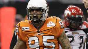 BC Lions Ricky Foley celebrates his tackle on Calgary Stampeders Joffrey Reynolds (rear) during CFL football action in Vancouver, British Columbia, October 31, 2009. REUTERS/Lyle Stafford