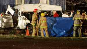 Ontario Provincial Police and emergency crews investigate a motor vehicle accident that killed 11 people near Hampstead, Ont., on Feb. 6, 2012. Dave Chidley/The Canadian Press