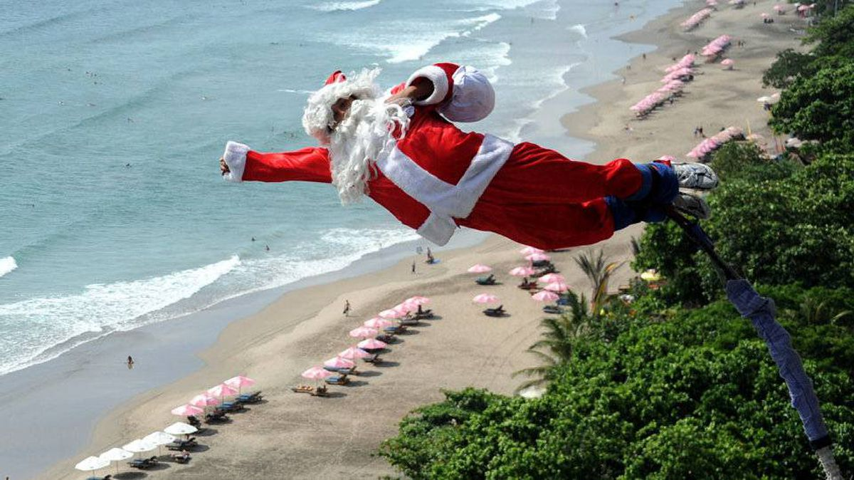 Santa bungee jumps above Kuta beach, on Indonesia's resort island of Bali.