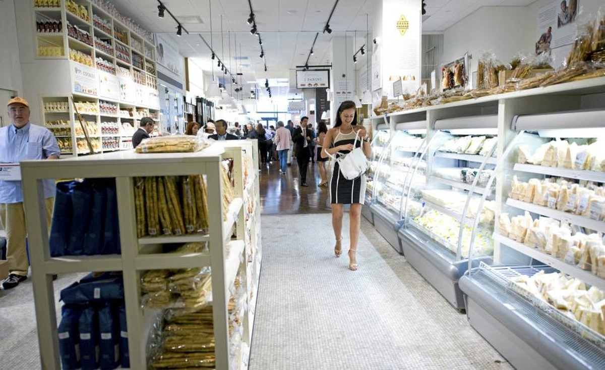 A woman browses at Eataly's flagship location in New York, which takes up a corner block.