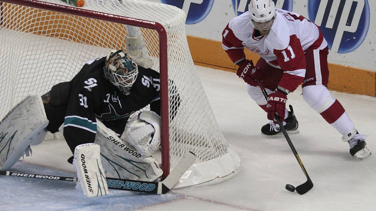 San Jose Sharks goalie Antti Niemi, of Finland, defends the goal as Detroit Red Wings right wing Daniel Cleary . (AP Photo/Jeff Chiu)