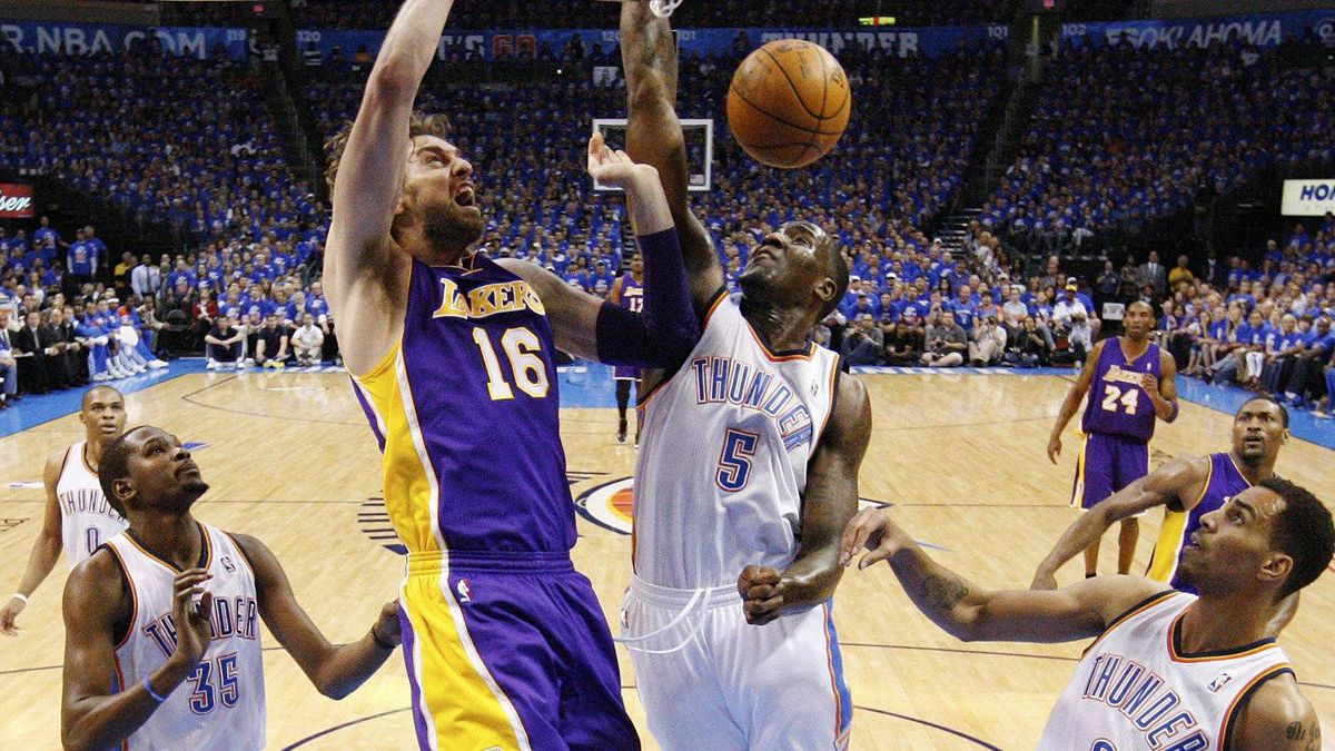 Los Angeles Lakers forward Pau Gasol (16) dunks between Oklahoma City Thunder forward Kevin Durant (35), center Kendrick Perkins (5) and guard Thabo Sefolosha (2) in the second quarter of Game 5 in their NBA basketball Western Conference semifinal playoff series, Monday, May 21, 2012, in Oklahoma City. (AP Photo/Sue Ogrocki)