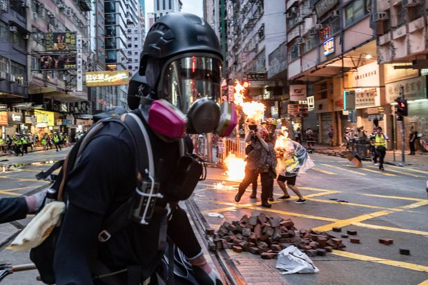 Petrol bombs and tear gas rock Hong Kong, as dozens arrested for defying ban on face masks