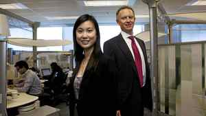 Consultant Bonnie Kwan and President and Managing Director for Accenture in Canada Bill Morris pose for a photo in their office in Mississauga, Ont.