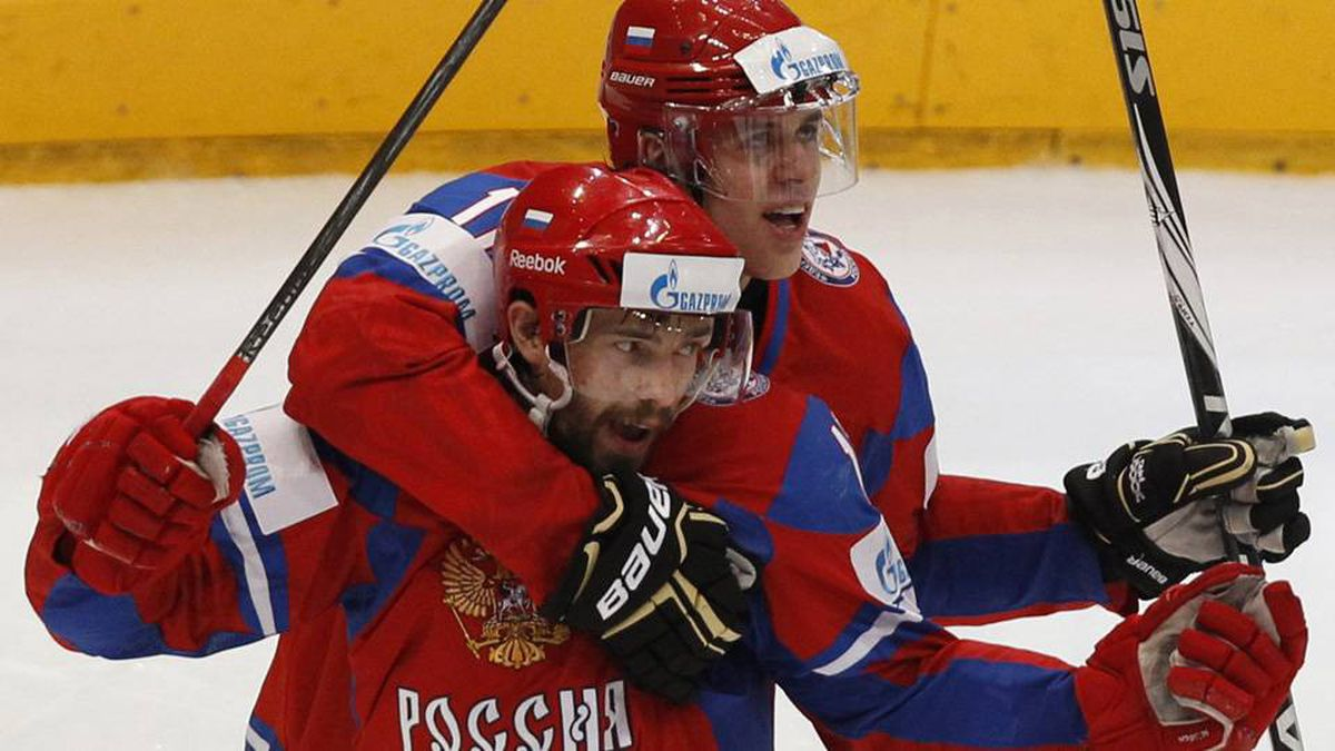 Russia's Pavel Datsyuk celebrates after scoring a goal against Canada with teammate Evgeni Malkin.