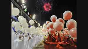 Revelers of Uniao da Ilha samba school perform at the Sambadrome during the second night of carnival parade in Rio de Janeiro, Brazil. Uniao da Ilha lost fancy dresses and floats in a fire that took place three weeks ago.