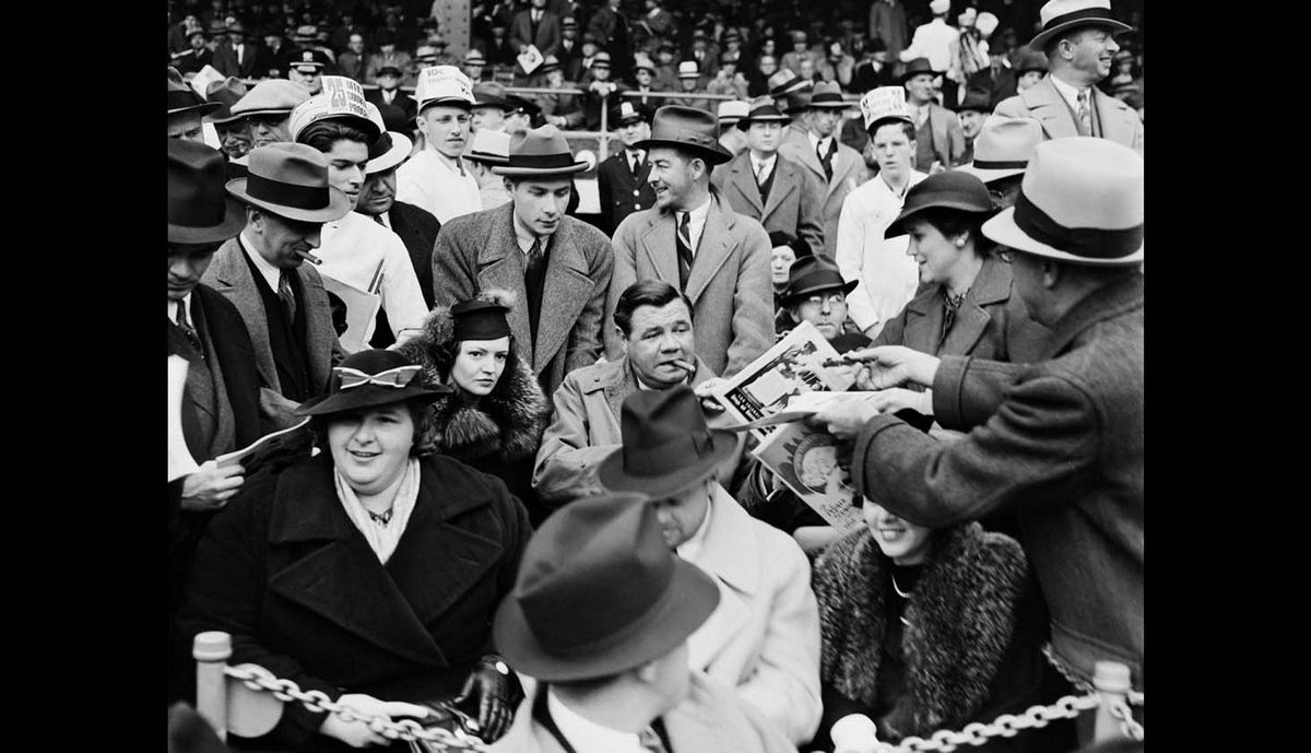 In this September 30, 1936, Works Progress Administration, Federal Writerís Project, photo provided by the New York City Municipal Archives, a man hands a program to baseball legend Babe Ruth, center, as he is joined by his second wife Clare, center left, and singer Kate Smith, front left, in the grandstand during Game 1 of the 1936 World Series at the Polo Grounds in New York.