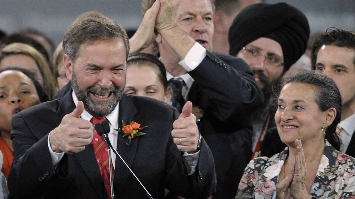 Thomas Mulcair shares the stage with his wife, Catherine Pinhas, after winning the NDP leadership in Toronto March 24, 2012.
