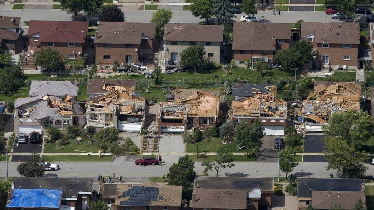 Damaged homes in Vaughan, Ont., on Aug. 21 after a tornado touched down in the neighbourhood north of Toronto on Thursday night.