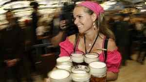 Oktoberfest waitress Babsi carries beer mugs during the first day at Munich's 175th Oktoberfest in Munich September 20, 2008.