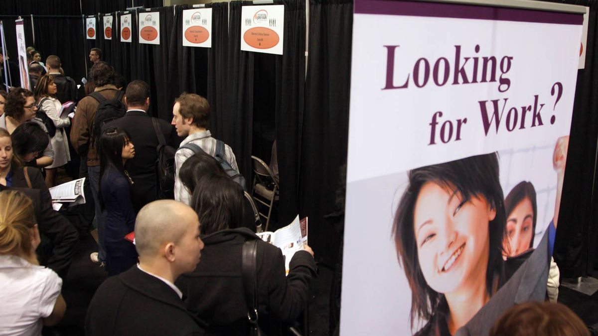Job seekers line up at a job fair and in Toronto. Fernando Morales/The Globe and Mail