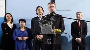 Netherlands's Finance Minister and Labour Party leader Wouter Bos, flanked by his party members, announces his party's withdrawal from Dutch Prime Minister Jan Peter Balkenende's three-party alliance in The Hague on Feb. 20, 2010.