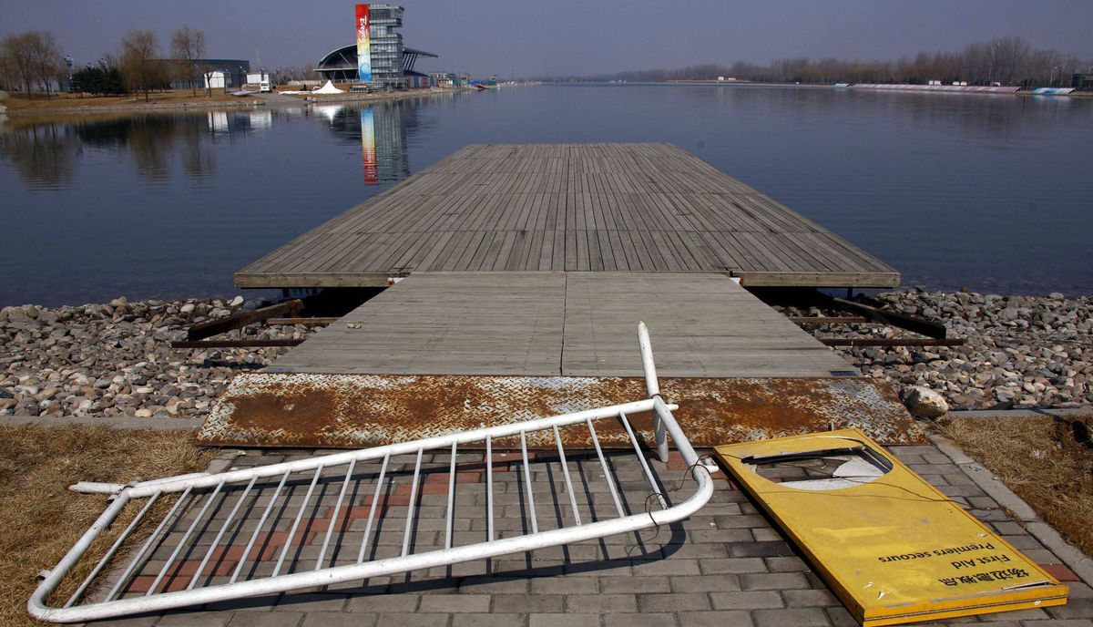 An old Olympic accreditation board lies on an unmaintained jetty at the deserted former venue for the 2008 Beijing Olympic Games rowing competition, located on the outskirts of Beijing March 27, 2012.