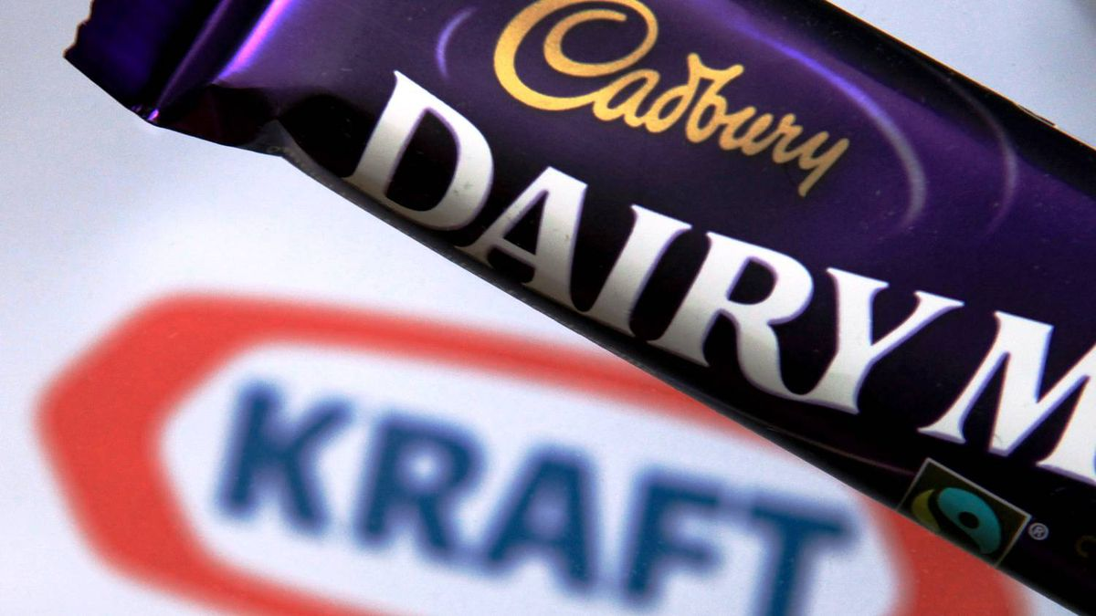 In this photograph illustration a bar of Cadbury's Dairy Milk is seen besides the Kraft logo