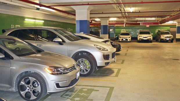 The spaces at WaterPark Place in Toronto are colour-coded green to clearly indicate EV charging spaces, one solution to the problem of gas-powered vehicles taking the spots.  WALLACE IMMEN /THE GLOBE AND MAIL