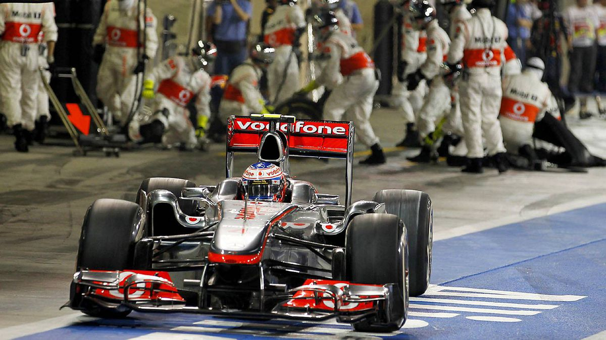 McLaren Formula One driver Jenson Button of Britain drives in the pit during the Abu Dhabi F1 Grand Prix at Yas Marina circuit in Abu Dhabi November 13, 2011.