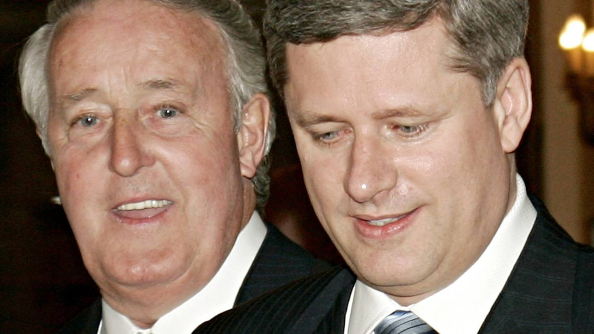 Prime Minister Stephen Harper and Brian Mulroney arrive at an Ottawa celebration of the former prime minister's time in office on April 20, 2006.
