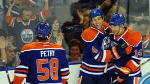 Edmonton Oilers' Jeff Petry, 58, Taylor Hall, 4, and Jordan Eberle, 14, celebrate Hall's second goal of the night during second period NHL pre-season hockey action in Edmonton on Tuesday, September 27, 2011.