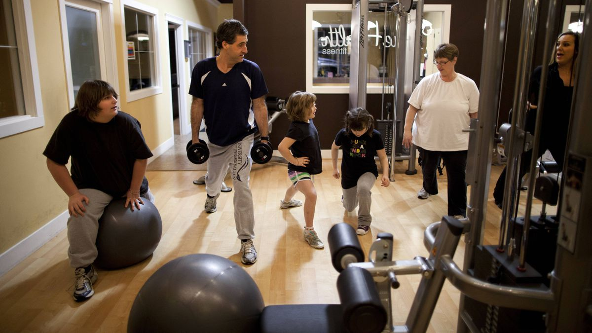 The Aarts family (from left) Keira,12, Jamie, 41, Kourtney, 7, Kassidy, 8, and Amber, 42, work out with trainer Tanya Stobbe.