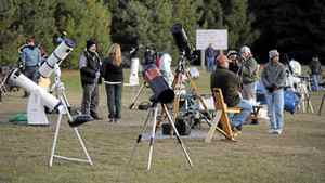 Astronomers set up telescopes on the beach at Mew Lake Campground in Algonquin Provincial Park, as they wait for night to fall so they can begin oberving the sky.