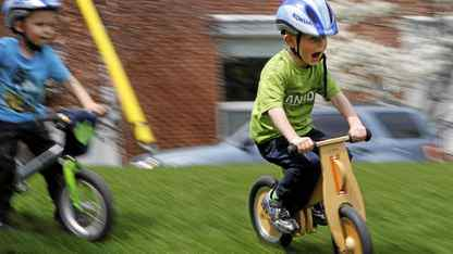 Two and a half-year-old Ben Metzner (L) and his four and a half-year-old friend Philip Scheibehenne ride their pedaless bikes imported and distributed in Canada by Philip's mother Sabine Scheibehenne under the brand Like a Bike, at Wanless Park in Toronto, April 23, 2011.
