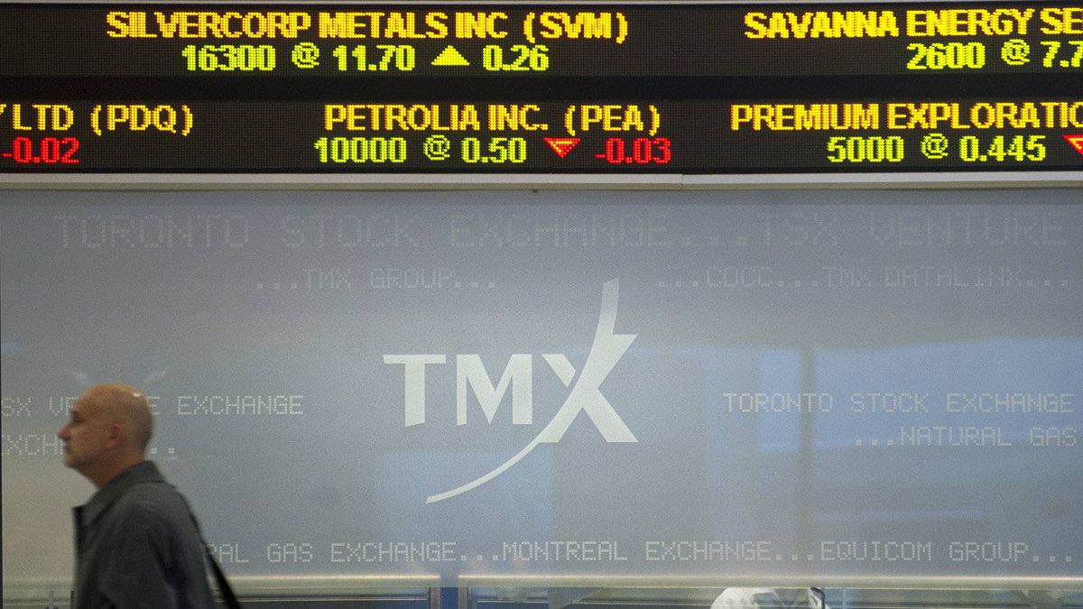A passerby is seen outside the Toronto Stock Exchange at the Exchange Tower in Toronto, Ont. Feb. 7/2011.