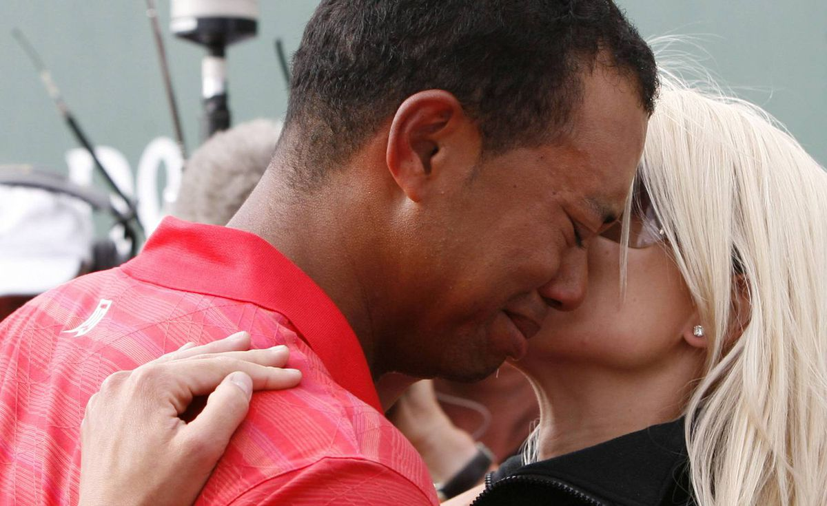 An emotional Tiger Woods is embraced by his wife Elin after winning the British Open Golf Championship at the Royal Liverpool Golf Course in Hoylake, England on July 23, 2006.