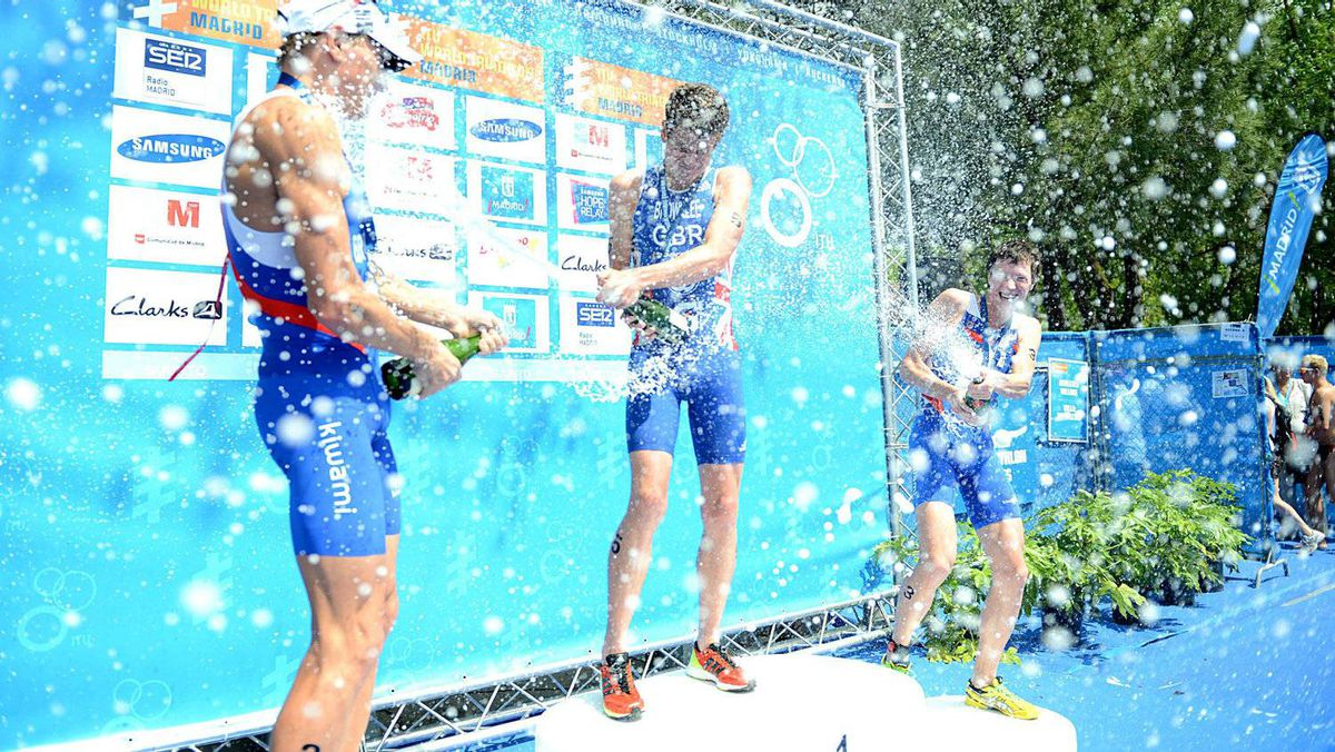 In this photo released by the International Triathlon Union, Great Britain's Jonathan Brownlee and Russian's Alexander Bryukhankov and Dmitry Polyanskiy celebrate on the podium of the 2012 ITU World Triathlon Madrid in Spain on Sunday May 27, 2012. Brownlee (centre) dominated the race for gold while Bryukhankov (left) won silver and Polyanskiy bronze (right). (AP Photo/ITU, Delly Carr)