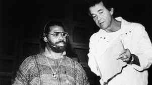"""In a January 25, 1986 file photo provided by ABC-TV Dick Clark, executive producer of the """"American Music Award"""" telecast, right, goes over production notes with singer Teddy Pendergrass during rehearsal at the Shirne Auditorium in Los Angeles."""