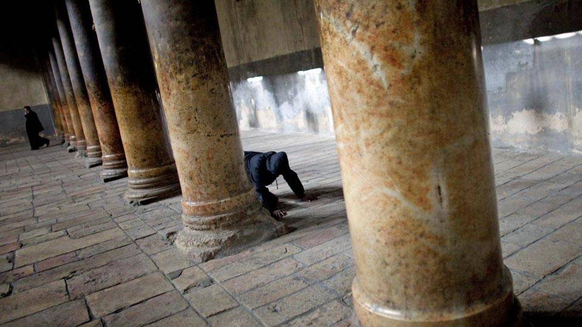 A visitor prays at the Church of the Nativity in Bethlehem, December 21, 2009.