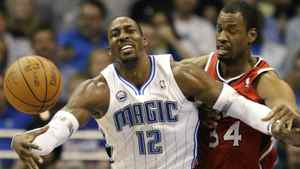 Orlando Magic center Dwight Howard (L) loses the ball against Atlanta Hawks center Jason Collins during the first half of Game 2 of their NBA Eastern Conference first round playoff basket ball game in Orlando, Florida April 19, 2011. REUTERS/Kevin Kolczynski