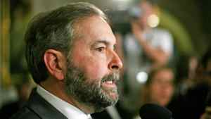 Opposition Leader Thomas Mulcair responds to the Conservative government's budget in the foyer of the House of Commons on March 29, 2012.