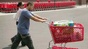 Customers leave a Target store with a cart full of merchandise in Chicago in 2007.