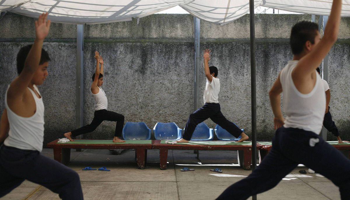 Inmates practice yoga during class inside a juvenile detention centre in Mexico City November 15, 2011.