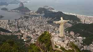 The statue of Christ the Redeemer towers over Rio de Janeiro (AP Photo/Felipe Dana)