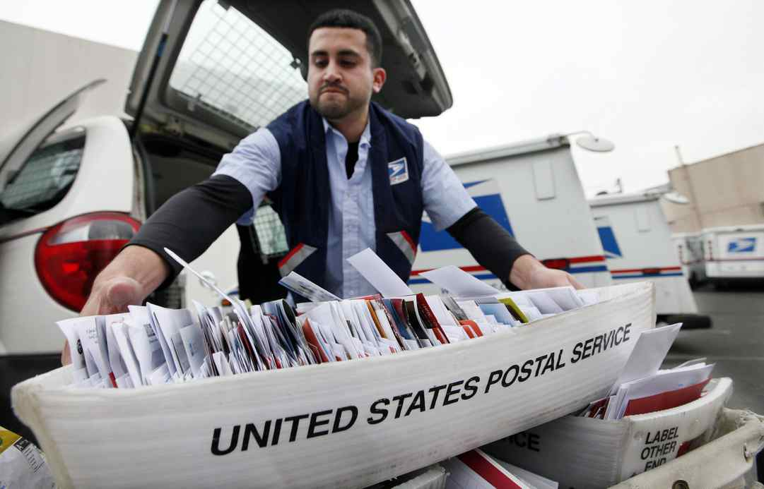 U.S. Postal Service plans to cut next-day delivery for first-class mail, shave 28,000 jobs in cost-cutting moves.