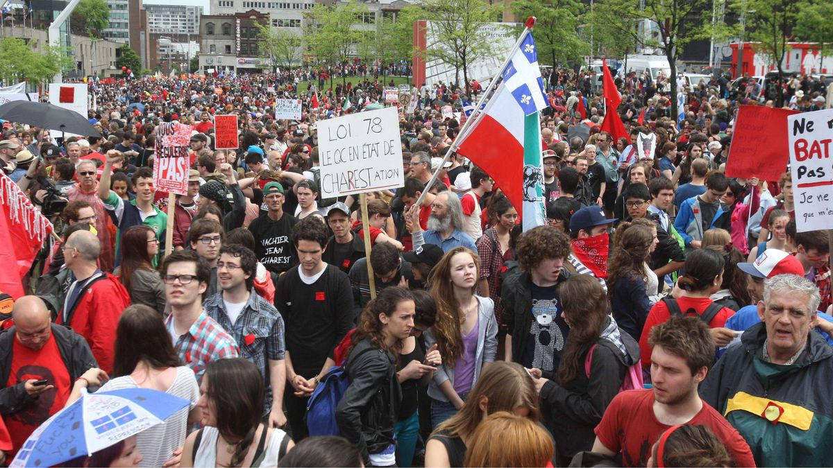 People gather at the start of a protest to mark the 100th day of a students strike, in Montreal, Tuesday, May 22, 2012.