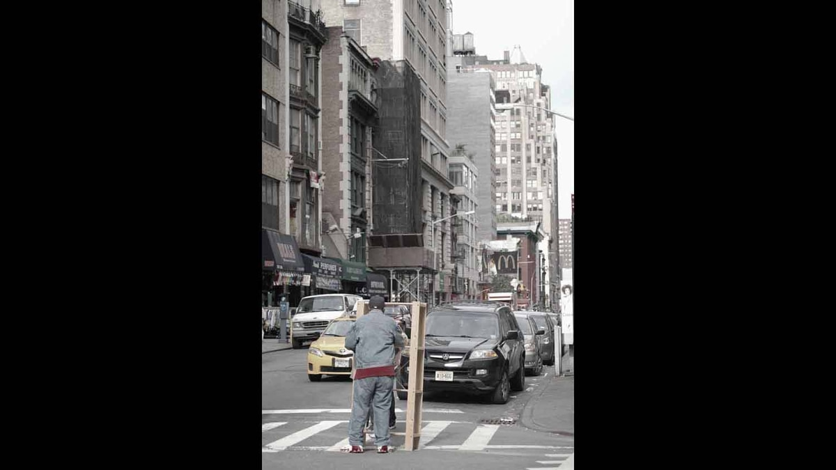 This picture was taken of a moving company employee in New York City in the Fall of 2011.