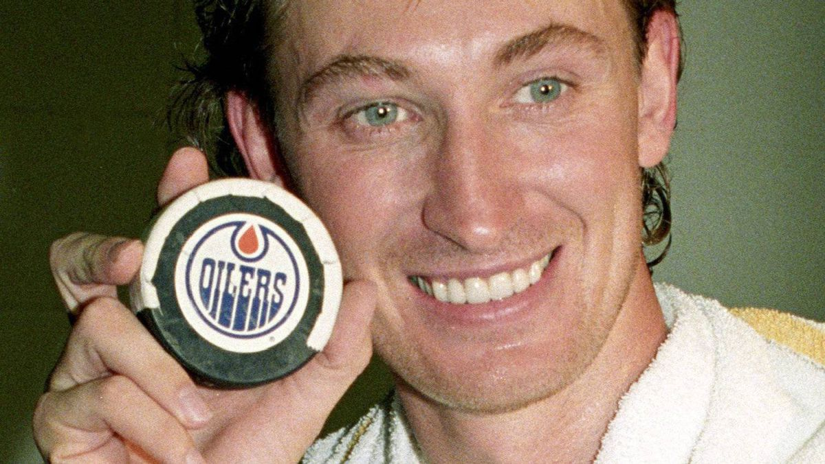 L.A. Kings' Wayne Gretzky holds up his record-breaking puck after breaking Gordie Howe's lifetime point record in Edmonton on Oct. 15, 1989. Gretzky's goal broke the point total of 1,850. Gretzky, the tousle-headed kid who turned the hockey world on its ear is hitting 50.