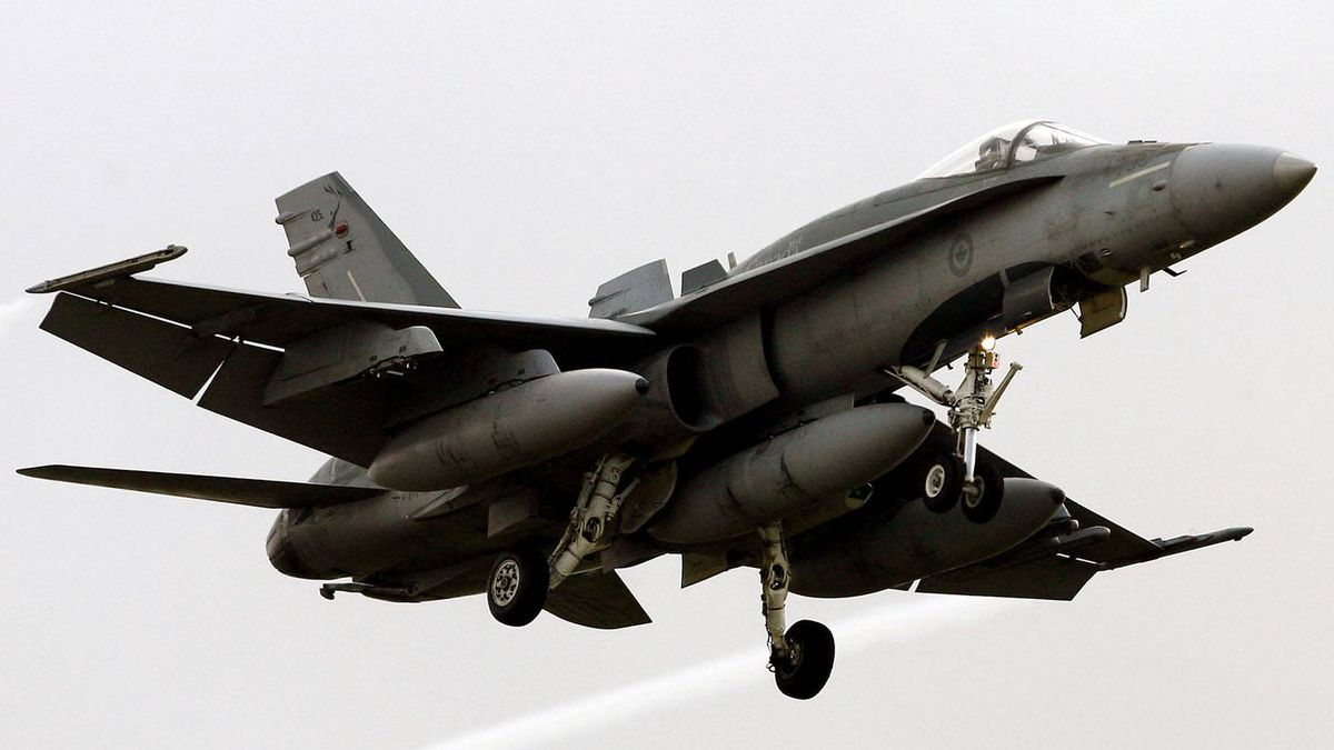An F18 Hornet of the Canadian air force arrives at the Trapani Birgi air base in the southern island of Sicily on March 18, 2011.