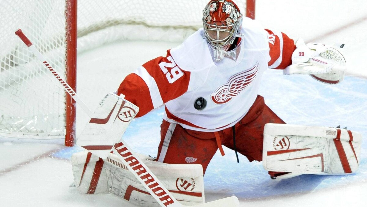 Detroit Red Wings goalie Ty Conklin blocks a shot against the Colorado Avalanche during the first period on Sunday, Dec. 4, 2011.