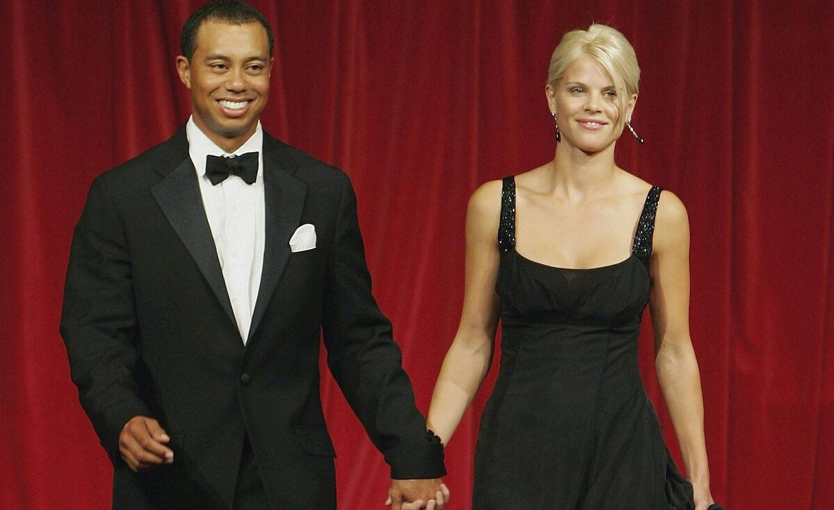 Tiger Woods and his wife Elin Nordegren walk down the catwalk during the Ryder Cup Gala Dinner at Citywest Hotel and Golf Resort on September 20, 2006 in Dublin, Ireland.