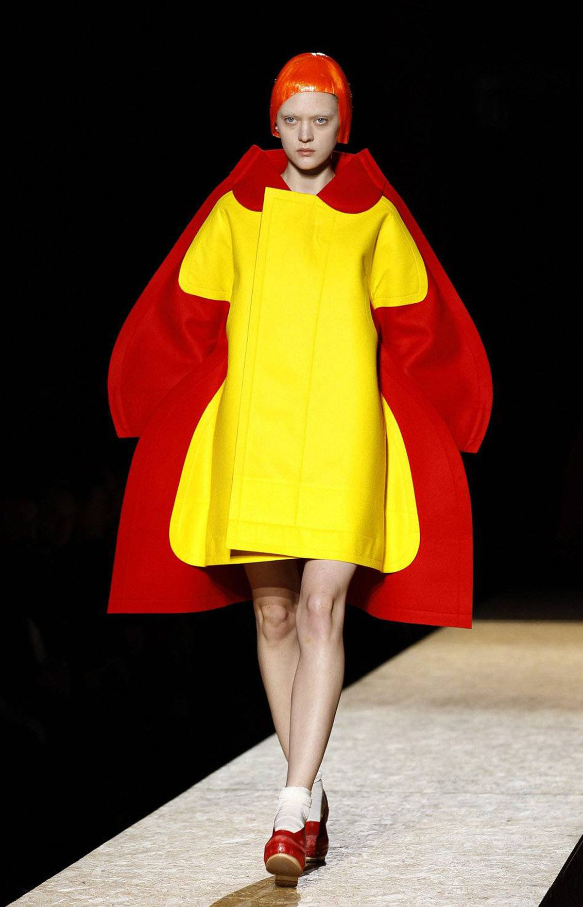 Just in case you had any doubt, this look proves that designer Rei Kawakubo realizes the absurdity of her theme. Interestingly and intentionally, the juxtaposition of dress-on-dress still manages to look completely flat.