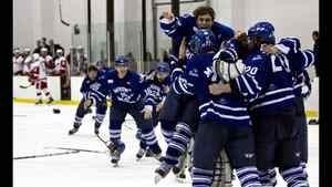 The Mount Royal University Cougars men's hockey team celebrates after defeating their rivals the SAIT Trojans in the 2010-2011 ACAC championship series.