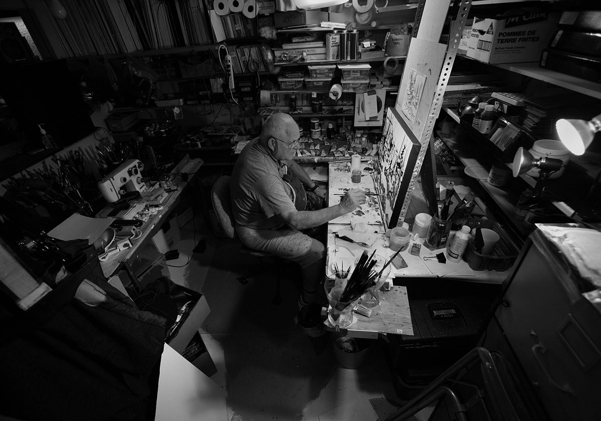 John Mlacak, a former employee and retiree of Nortel, works in his painting studio.