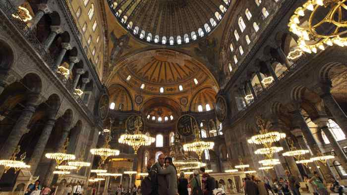 A couple takes pictures as they visit the Byzantine monument of Hagia Sophia in Istanbul May 25, 2011.